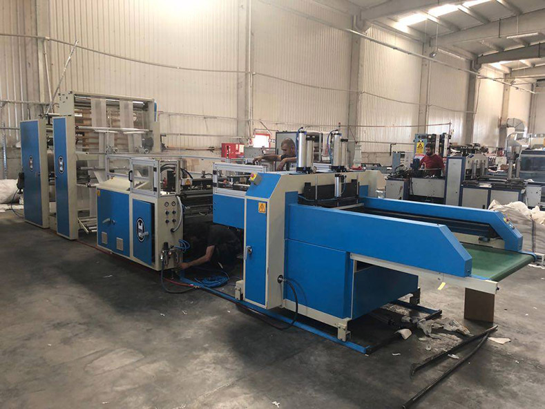 Our Turkey customer ordered a automatic T-Shirt bag making machine. (HG2P - 502SA)